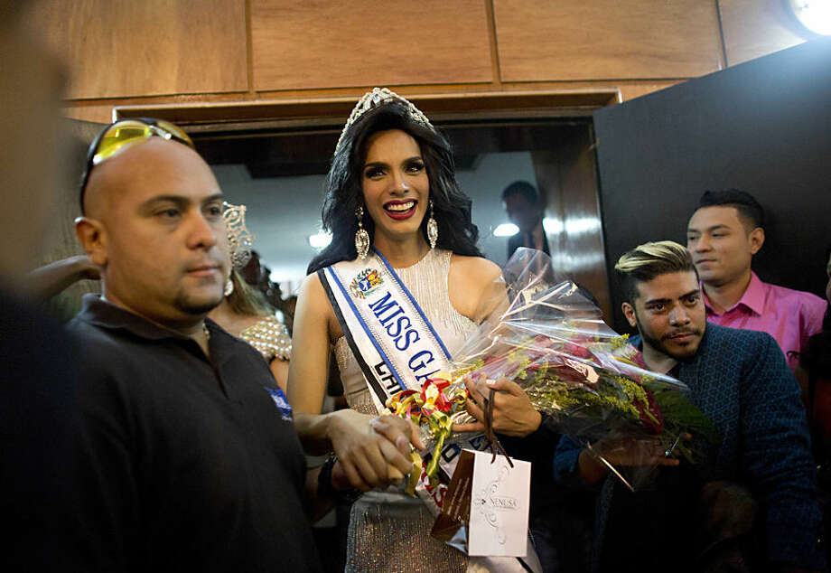 "In this Oct. 18, 2015 photo, Argenis Gonzalez wears the Miss Gay Venezuela crown after winning the beauty pageant in Caracas, Venezuela. ""It's a great achievement to get to be the face of what is such a large community in Latin America, and even bigger in our country,"" said Gonzalez, a 24-year-old social media coordinator. ""And to have so many straight people cheering us on makes me feel really privileged."" When not dressed as a woman, Gonzalez goes by the first name Manuel. (AP Photo/Ariana Cubillos)"