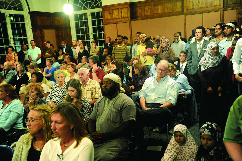 Residents fill the Community Room at Norwalk City Hall Tuesday night as the Common Council votes on the monetary portion of the proposed settlement between Norwalk and the Al Madany Islamic Center of Norwalk. Hour photo/Matthew Vinci