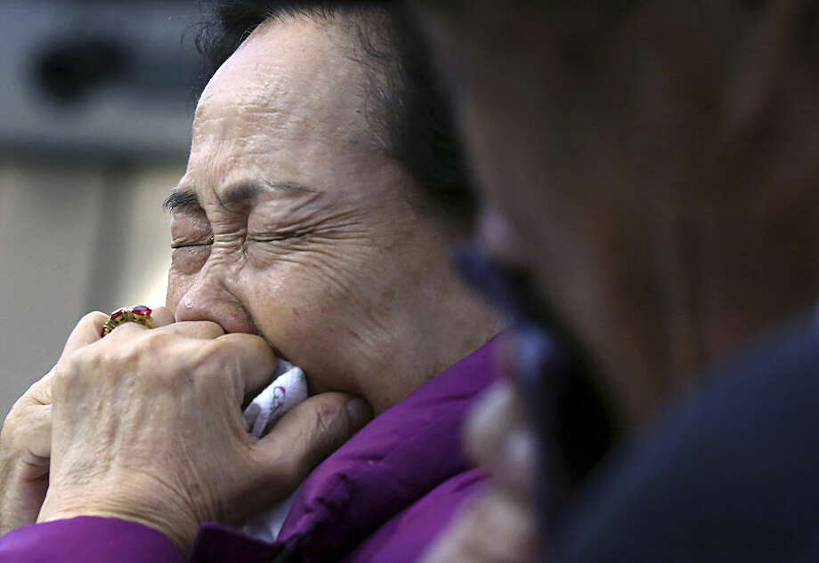 South Korean Mun Jung-ok cries as she bids farewell to her North Korean relative after the Separated Family Reunion Meeting at the Diamond Mountain resort in North Korea, Thursday, Oct. 22, 2015. Hundreds of elderly Koreans are weeping and embracing as they part - perhaps for good - after briefly reuniting for the first time in more than 60 years. About 390 South Koreans traveled to the North's scenic Diamond mountain resort earlier this week to meet for three days with relatives they were separated from during the turmoil of the 1950-53 Korean War. (Kim Do-hoon/Yonhap via AP) KOREA OUT