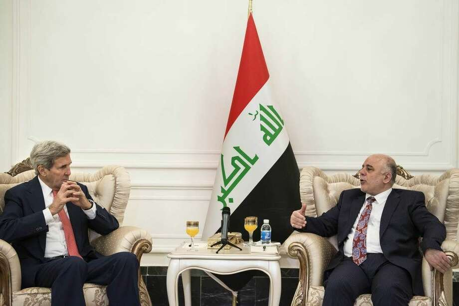 U.S. Secretary of State John Kerry, left, listens to new Iraqi Prime Minister Haider al-Abadi during a meeting in Baghdad, Iraq, Wednesday, Sept. 10, 2014. Kerry is traveling to the mideast this week to discuss ways to bolster the stability of the new Iraqi government and combat the Islamic State militant group that has taken over large swaths of Iraq and Syria. (AP Photo/Brendan Smialowski, Pool)