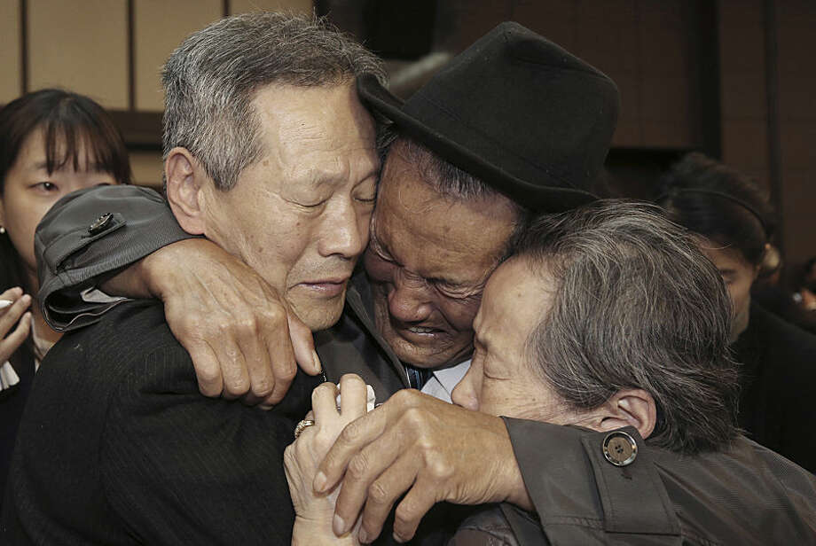 North Korean Son Kwon Geun, center, weeps with his South Korean relatives as he bids farewell after the Separated Family Reunion Meeting at Diamond Mountain resort in North Korea, Thursday, Oct. 22, 2015. Hundreds of elderly Koreans are weeping and embracing as they part - perhaps for good - after briefly reuniting for the first time in more than 60 years. About 390 South Koreans traveled to the North's scenic Diamond mountain resort earlier this week to meet for three days with relatives they were separated from during the turmoil of the 1950-53 Korean War. (Korea Pool Photo via AP) KOREA OUT
