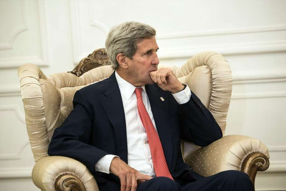 U.S. Secretary of State John Kerry, listens to new Iraqi Prime Minister Haider al-Abadi during a meeting in Baghdad, Iraq, Wednesday, Sept. 10, 2014. Kerry is traveling to the mideast this week to discuss ways to bolster the stability of the new Iraqi government and combat the Islamic State militant group that has taken over large swaths of Iraq and Syria. (AP Photo/Brendan Smialowski, Pool)