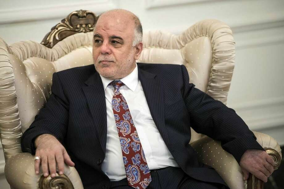 Iraqi Prime Minister Haider al-Abadi meets with U.S. Secretary of State John Kerry in Baghdad, Iraq, Wednesday, Sept. 10, 2014. Kerry is traveling to the mideast this week to discuss ways to bolster the stability of the new Iraqi government and combat the Islamic State militant group that has taken over large swaths of Iraq and Syria. (AP Photo/Brendan Smialowski, Pool)