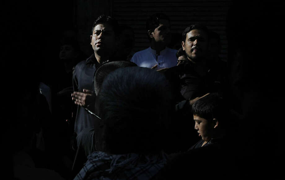 Mourning Pakistani Shiite Muslims beat their chests during the month of Muharram ahead of Ashoura day, in Peshawar, Pakistan, Wednesday, Oct. 21, 2015. Ashoura is a Shiite Muslim commemoration marking the death of Hussein, the Prophet Muhammad's grandson, at the Battle of Karbala in present-day Iraq. (AP Photo/Mohammad Sajjad)