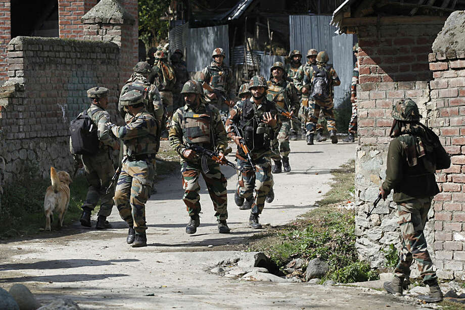 Indian army soldiers take position near the site of gunbattle with suspected rebels in Bungham village, northwest of Srinagar, Indian controlled Kashmir, Wednesday, Oct. 21, 2015. Indian government forces killed a suspected rebel in a gunbattle Wednesday in the disputed Himalayan region of Kashmir, officials said. (AP Photo/Dar Yasin)