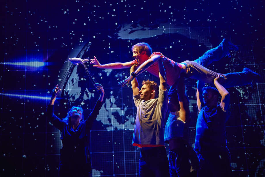 "This image released by Boneau/Bryan-Brown shows the cast during a performance of ""The Curious Incident of the Dog in the Night-Time,"" in London. The play by Simon Stephens was adapted from Mark Haddon's best-selling novel of the same name and is directed by Tony Award-winner Marianne Elliott. (AP Photo/Boneau/Bryan-Brown, Brinkhoff-Moegenburg)"
