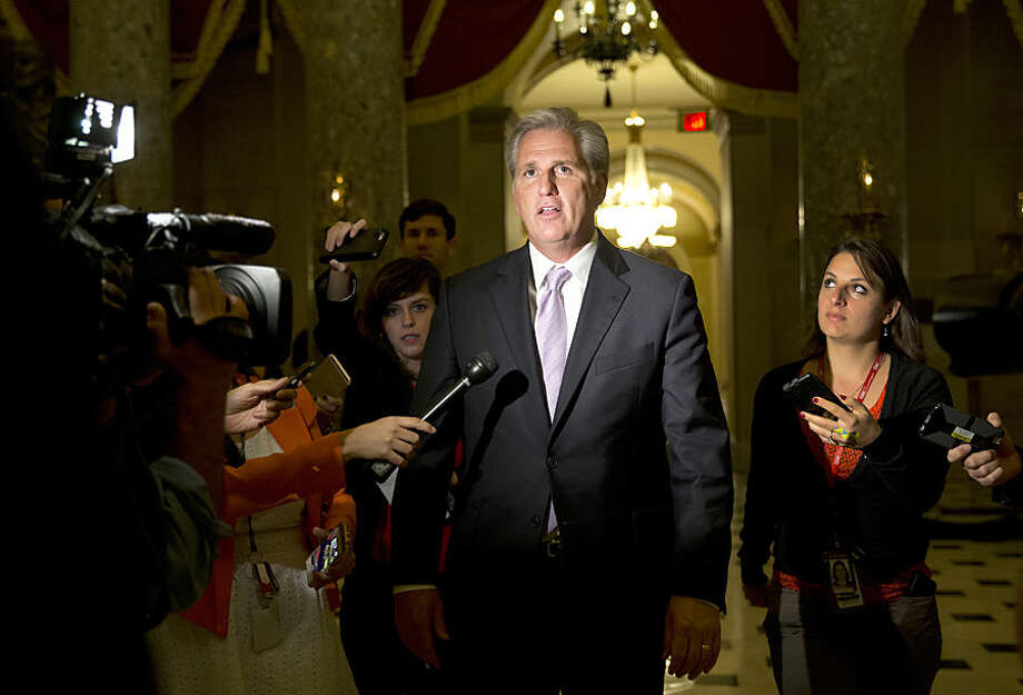 House Majority Leader Kevin McCarthy of Calif., talks to media a he walks from a group meeting with Rep. Paul Ryan, R-Wis., Capitol Hill in Washington, Wednesday, Oct. 21, 2015. Ryan seeking unity in a place it's rarely found, is telling House Republicans he will serve as their speaker only if they embrace him by week's end as their consensus candidate. (AP Photo/Carolyn Kaster)