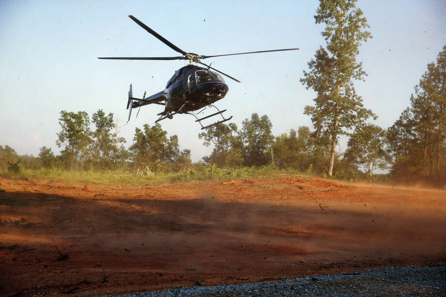 A state trooper helicopter lands near the area where authorities are gathering on Tuesday, Sept. 9, 2014, in Camden, Ala. A district attorney says the bodies of five children missing from South Carolina have been found in Camden. (AP Photo/Brynn Anderson)