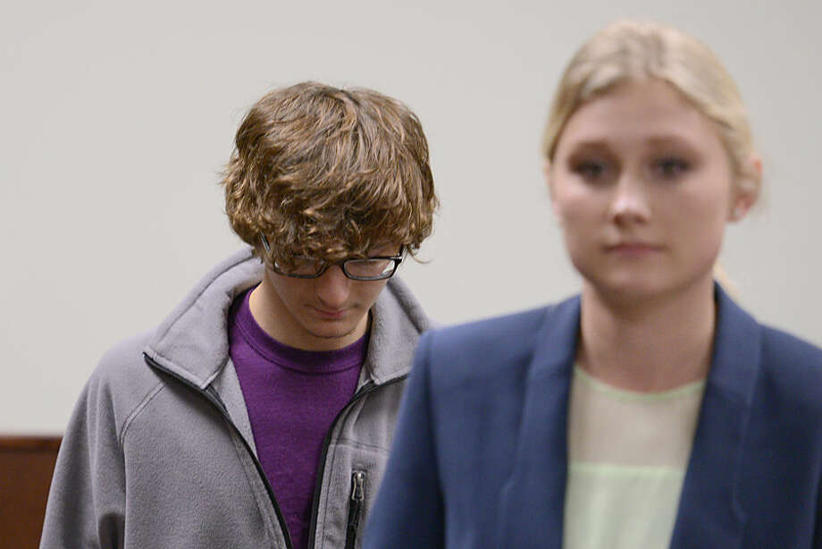 Christopher Leonard appears in court to give a sworn testimony during a felony hearing for his half-sister, Sarah Ferguson on Wednesday, Oct. 21, 2015, in New Hartford, N.Y. Ferguson is accused of second-degree assault for allegedly beating Christopher Leonard. Her case case will be sent to Oneida County Clerk for grand jury consideration. Christopher sustained injuries during a counseling session turned violent at Word of Life Church while his brother, Lucas Leonard, died from injuries related to the violent counseling session. (Tina Russell/Observer-Dispatch via AP, Pool)