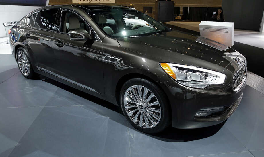 FILE - In this Feb. 7, 2014 file photo, a Kia 2015 K900, V8 is displayed during the media preview of the Chicago Auto Show at McCormick Place in Chicago. The K900 is an attractive, large, luxury sedan with a quiet, comfortable ride, a boatload of standard features and a value price compared with luxury-brand competitors. (AP photo/Nam Y. Huh, File)