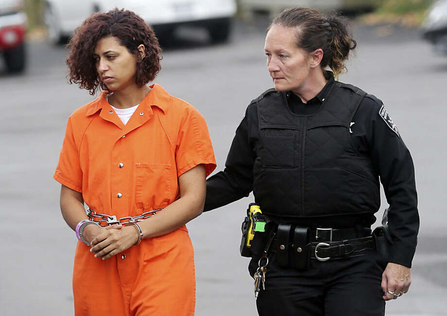 Sarah Ferguson is escorted to New Hartford Town Court for a hearing, Wednesday, Oct. 21, 2015, in New Hartford, N.Y. The surviving brother of a pair of teenagers viciously beaten during a counseling session at Word of Life Christian Church testified against Ferguson, who is among six church members charged in the attack. (AP Photo/Mike Groll)