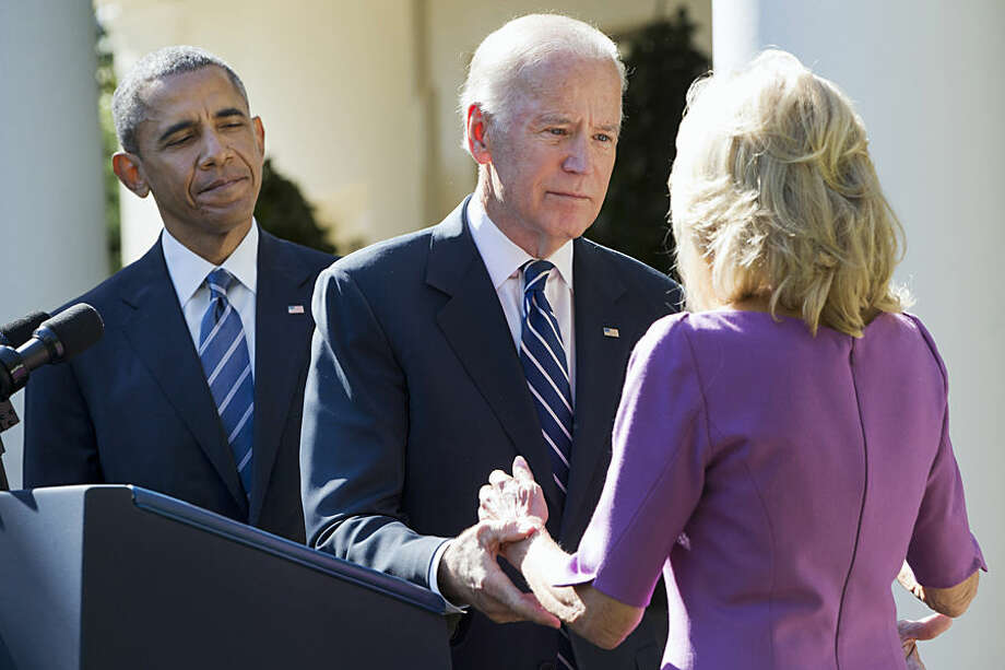 President Barack Obama watches as Vice President Joe Biden turns to his wife Dr. Jill Biden after announcing that he will not run for the presidential nomination, Wednesday, Oct. 21, 2015, in the Rose Garden of the White House in Washington. (AP Photo/Jacquelyn Martin)