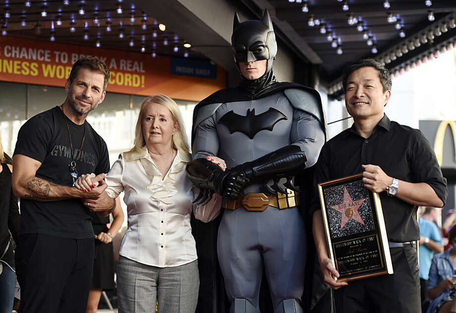 """Elizabeth Kane, second from left, widow of late """"Batman"""" creator Bob Kane, poses with """"Batman v Superman: Dawn of Justice"""" director Zack Snyder, left, DC Entertainment co-publisher and artist Jim Lee, right, and a costumed """"Batman"""" character after Bob Kane received a star on the Hollywood Walk of Fame on Wednesday, Oct. 21, 2015, in Los Angeles. (Photo by Chris Pizzello/Invision/AP)"""