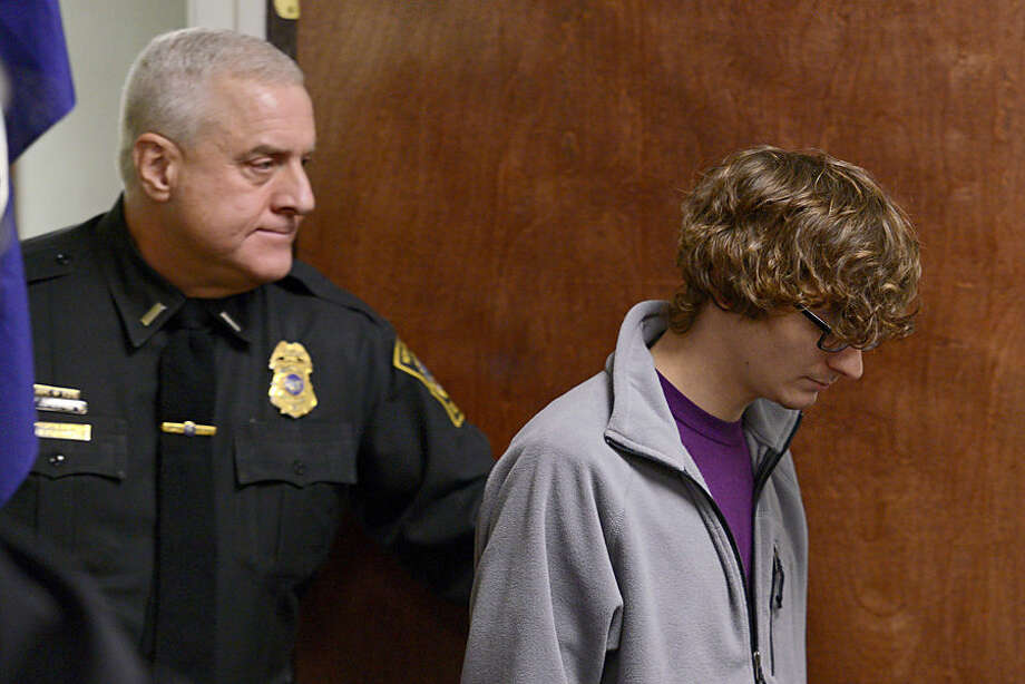 Christopher Leonard, right, appears in court to give a sworn testimony during a felony hearing for his half-sister, Sarah Ferguson on Wednesday, Oct. 21, 2015, in New Hartford, N.Y. Ferguson is accused of second-degree assault for allegedly beating Christopher Leonard. Her case case will be sent to Oneida County Clerk for grand jury consideration. Christopher sustained injuries during a counseling session turned violent at Word of Life Church while his brother, Lucas Leonard, died from injuries related to the violent counseling session. (Tina Russell/Observer-Dispatch via AP, Pool)