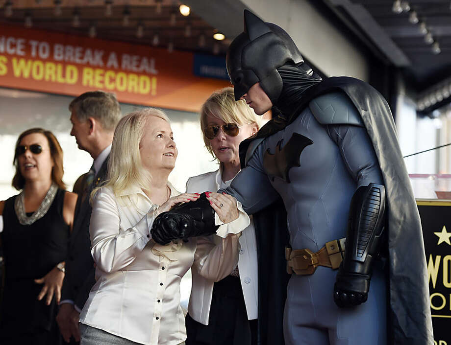 "A costumed ""Batman"" character escorts Elizabeth Kane, widow of late ""Batman"" creator Bob Kane, to a ceremony honoring her husband with a star on the Hollywood Walk of Fame on Wednesday, Oct. 21, 2015, in Los Angeles. Kane would have turned 100 years old on Saturday, Oct. 24. (Photo by Chris Pizzello/Invision/AP)"