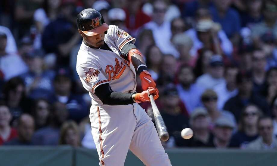Baltimore Orioles' Adam Jones connects on a two-run double against the Boston Red Sox during the third inning of a baseball game at Fenway Park in Boston, Wednesday, Sept. 10, 2014. (AP Photo/Charles Krupa)