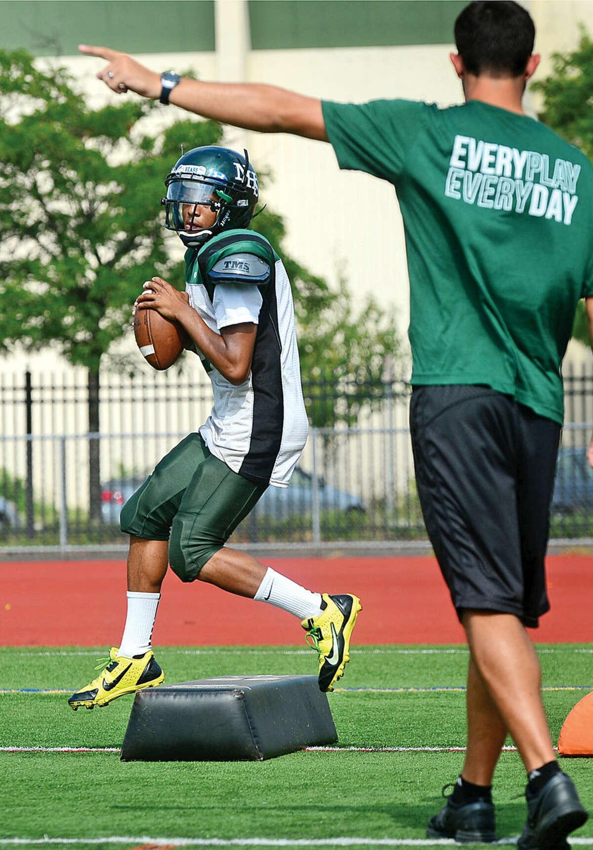Hour photo / Erik Trautmann Norwalk High School quarterback Jeremy Linto practices Saturday at Testa Field.