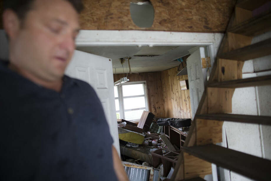In this Sept. 5, 2014 photo, Gary Silberman guides reporters on a tour of his parent's home that was destroyed by Superstorm Sandy in Lindenhurst, N.Y. After receiving nearly $17,000 in assistance from FEMA, the agency is demanding a return on the funds. (AP Photo/John Minchillo)