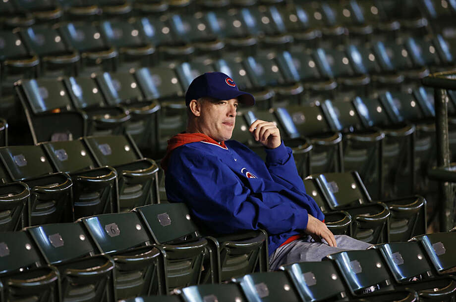 A Chicago Cubs fan stays in his seat after Game 4 of the National League baseball championship series against the New York Mets Wednesday, Oct. 21, 2015, in Chicago. The Mets won 8-3 to advance to the World Series. (AP Photo/Charles Rex Arbogast)