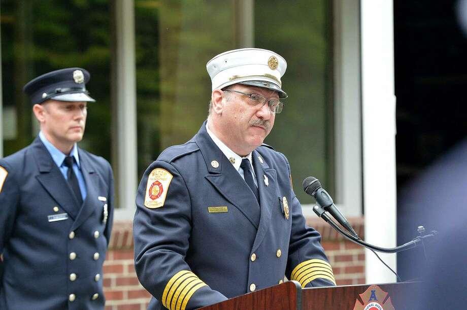 Hour Photo/Alex von Kleydorff Wilton Fire Chief Ronald Kanterman speaks during Wilton's 13th Annual 9-11 Memorial Service at Wilton fire Headquarters