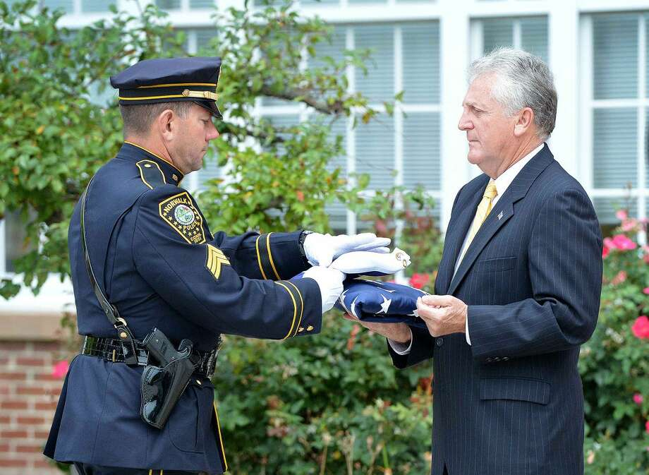 Hour Photo/Alex von Kleydorff Mayor Harry Rilling accepts the Flag of Honor during Norwalk Remembers , 9-11 Rememberance Ceremony at City Hall