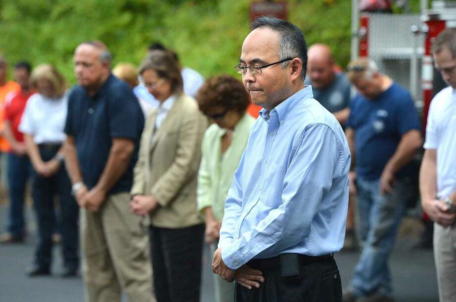 Hour Photo/Alex von Kleydorff People reflect during a moment of prayer during Wilton's 13th Annual 9-11 Memorial Service at Wilton fire Headquarters
