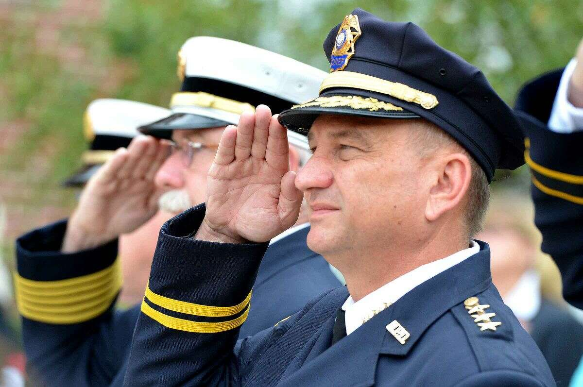 Hour Photo/Alex von Kleydorff Police Chief Tom Kulhawick and Fire Chief Denis McCarthy during Norwalk Remembers , 9-11 Rememberance Ceremony at City Hall