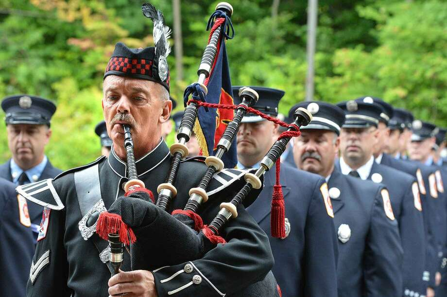 Hour Photo/Alex von Kleydorff Wilton Fire Department's Ralph Nathanson plays the bagpipes during a procession at Wilton's 13th Annual 9-11 Memorial Service at Wilton fire Headquarters