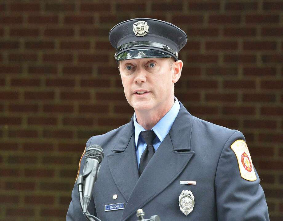 Hour Photo/Alex von Kleydorff Wilton Firefighter James Blanchfield speaks during Wilton's 13th Annual 9-11 Memorial Service at Wilton fire Headquarters