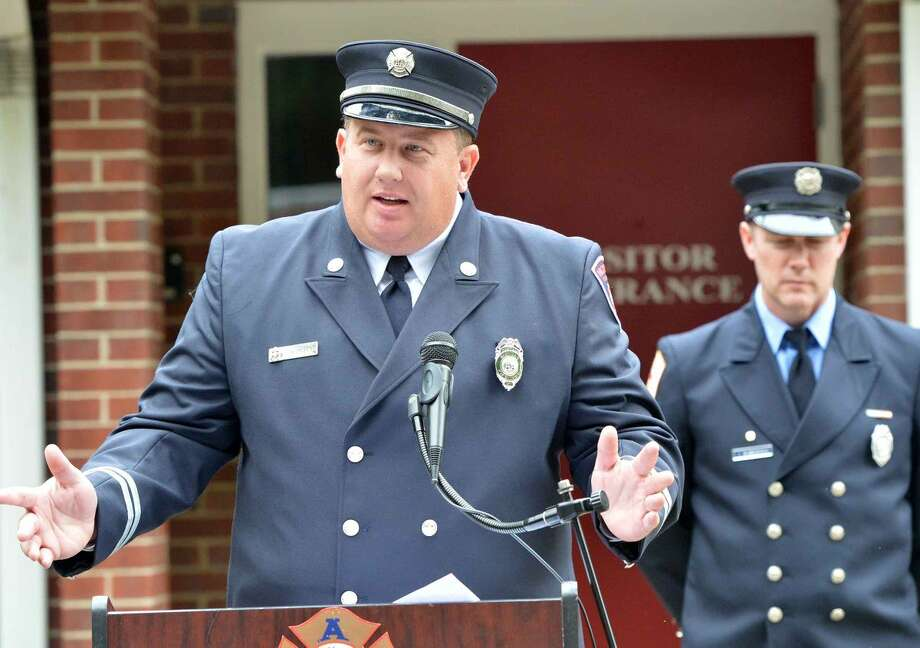 Hour Photo/Alex von Kleydorff Jason Mumbach speaks during Wilton's 13th Annual 9-11 Memorial Service at Wilton fire Headquarters
