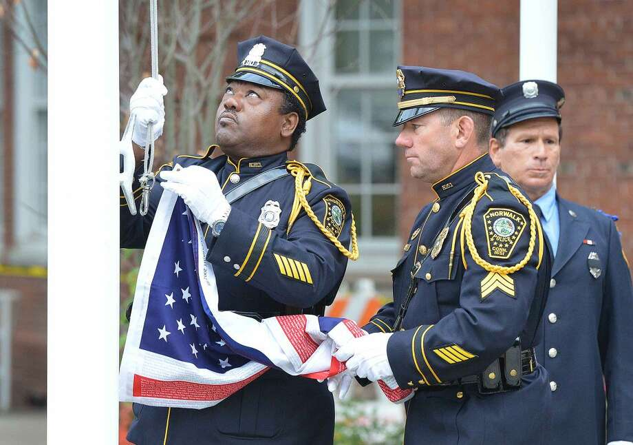 Hour Photo/Alex von Kleydorff The Honor Guard raises the colors during Norwalk Remembers , 9-11 Rememberance Ceremony at City Hall