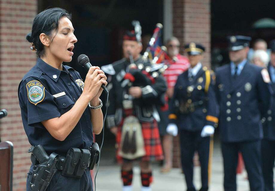 Hour Photo/Alex von Kleydorff Wilton Police Officer Anna Tornello sings God Bless America during Wilton's 13th Annual 9-11 Memorial Service at Wilton fire Headquarters