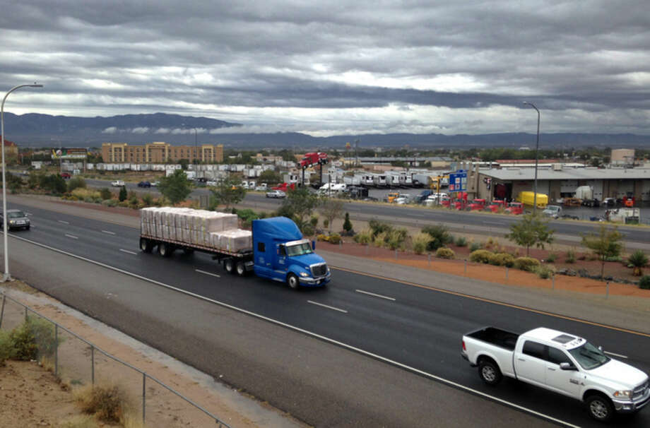 Cars race along a busy section of Interstate 40 in Albuquerque, N.M., Wednesday, Oct. 21, 2015, where police say a 4-year-old girl was shot during an apparent road-rage argument. Albuquerque police are looking for a man in his mid-20s or early-30s who was driving a recent model maroon or dark red Toyota Corolla or Camry with New Mexico license plates in connection to the shooting that occurred on Tuesday, Oct. 20. (AP Photo/Russell Contreras)