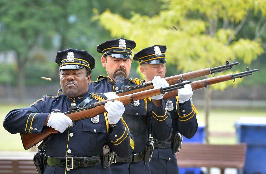 Hour Photo/Alex von Kleydorff Norwalk Fire department and Police Department Joint Honor Guard fire a gun salute during Norwalk Remembers , 9-11 Rememberance Ceremony at City Hall