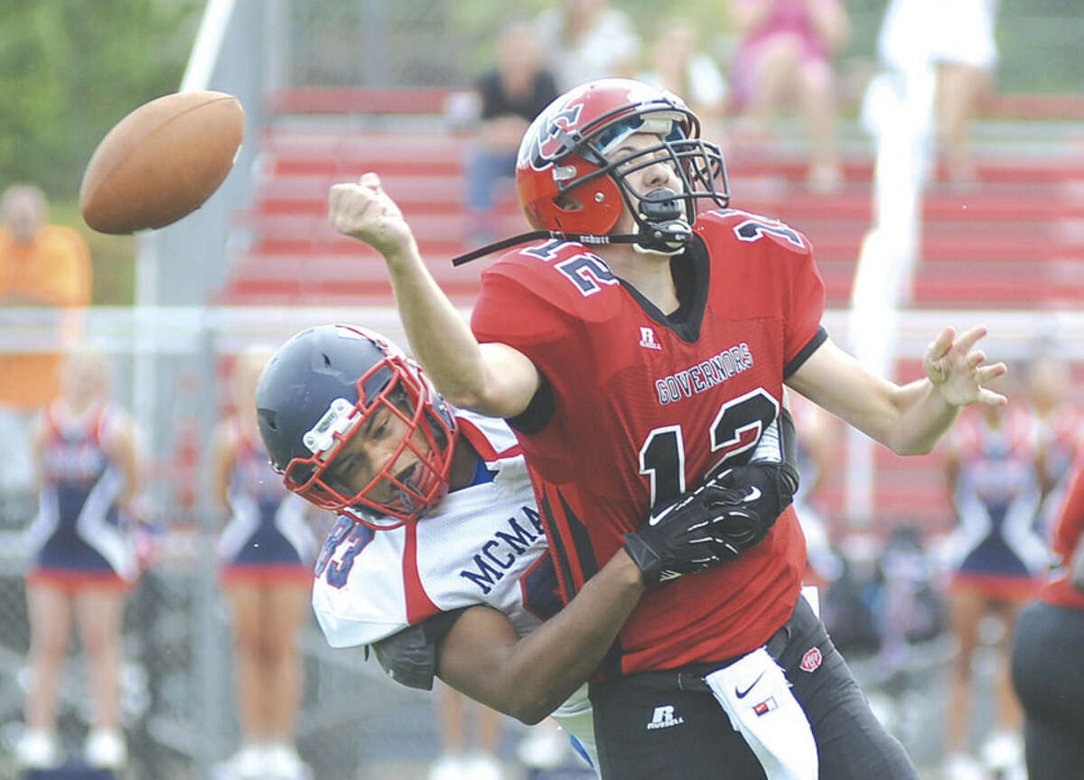 Hour photo/John Nash Brien McMahon's Kyle Davis, rear, blindsides Wilbur Cross quarterback A.J. Consiglio, forcing a second quarter fumble in Thursday afternoon's season-opening non-conference game in New Haven. The host Governors won 29-14.