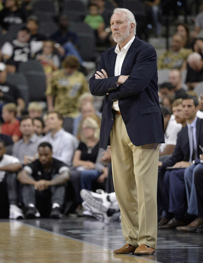 San Antonio Spurs head coach Gregg Popovich watches play during the first half of a preseason NBA basketball game against the Detroit Pistons, Sunday, Oct. 18, 2015, in San Antonio. San Antonio won 96-92. (AP Photo/Darren Abate)