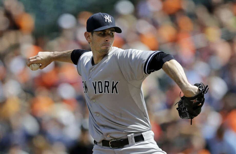 New York Yankees starting pitcher Brandon McCarthy throws to the Baltimore Orioles during the first inning in the first baseball game of a doubleheader, Friday, Sept. 12, 2014, in Baltimore. (AP Photo/Patrick Semansky)