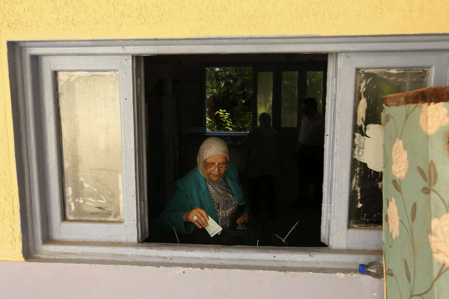 An Egyptian woman casts her vote at polling station during the first round of Egyptian parliamentary elections, in Alexandria, Egypt, Sunday, Oct. 18, 2015. (AP Photo/Hassan Ammar)