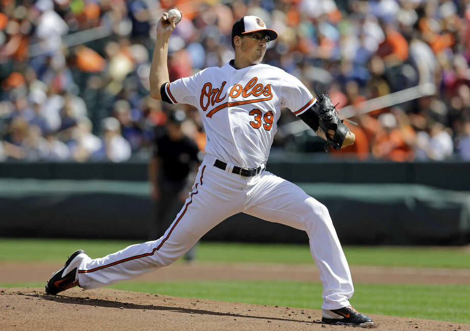 Baltimore Orioles starting pitcher Kevin Gausman throws to the New York Yankees during the first inning in the first baseball game of a doubleheader, Friday, Sept. 12, 2014, in Baltimore. (AP Photo/Patrick Semansky)