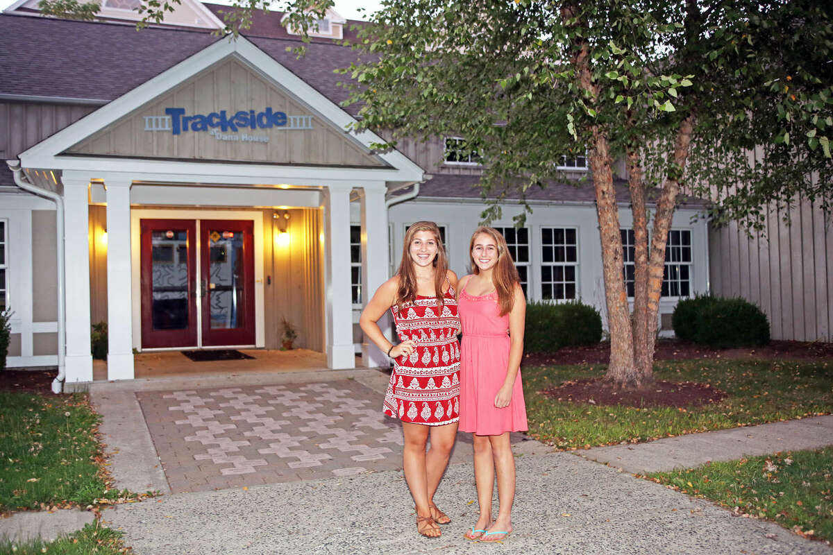 New Presidents of Safe Rides Cecilia Babchak and Maddie Gilliespie pose for a photo outside of the Trackside Teen Center in Wilton.