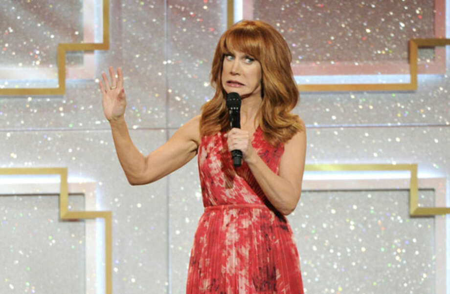 FILE - In this June 22, 2014 file photo, host Kathy Griffin speaks on stage at the 41st annual Daytime Emmy Awards at the Beverly Hilton Hotel, in Beverly Hills, Calif. There has been no progress in adding women or minorities to the ranks of late-night network talk shows since Joan Rivers held the job on Fox 30 years ago. Griffin, a close friend of Rivers, said women don't get a fair chance at network late-night host jobs. (Photo by Chris Pizzello/Invision/AP, file)