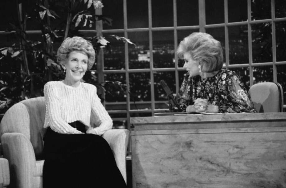 "FILE - In this Oct. 30, 1986 file photo, talk show host Joan Rivers, right, talks with guest, first lady Nancy Reagan, during her appearance on ""The Late Show Starring Joan Rivers,"" on Fox TV. There has been no progress in adding women or minorities to the ranks of late-night network talk shows since Rivers held the job on Fox 30 years ago. (AP Photo, Reed Saxon, File)"