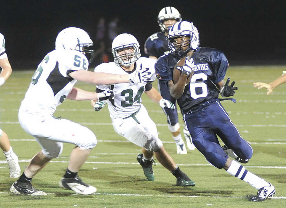 Hour photo/John NashWilton's Rod Djaly Thoby (6) returns a punt return during Thursday night's season-opening game against Guilford at Fujitani Field in Wilton.