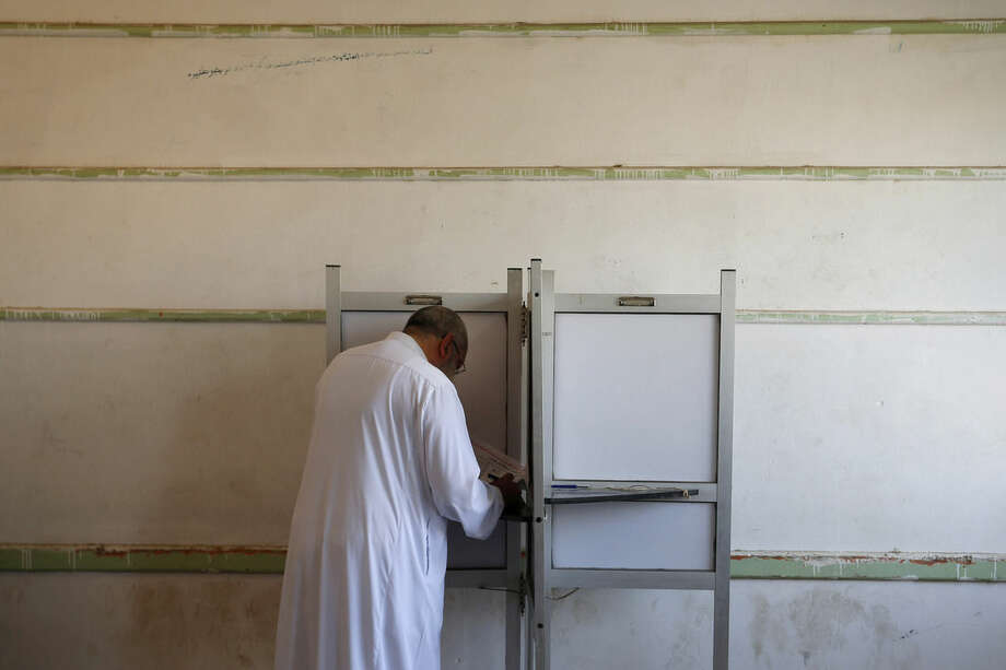 The deputy head of Egypt's ultraconservative al-Nour Party cleric Yasser El-Borhamy, casts his vote during the first round of Egyptian parliamentary elections, at a polling station in Alexandria, Egypt, Sunday, Oct. 18, 2015. (AP Photo/Hassan Ammar)