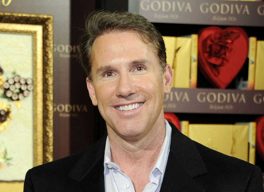 """FILE - In this Feb. 1, 2012 file photo writer-producer Nicholas Sparks poses in New York. Sparks is executive producer of the television movie """"Deliverance Creek"""" that premieres on the Lifetime network Sept. 15, 2014, at 8 p.m. EDT. (AP Photo/Evan Agostini, File)"""