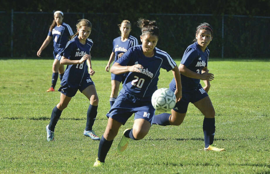 Hour Photo/Alex von KleydorffMcMahon's Brenda Vega (20) chanses down a ball Friday against Trinity Catholic.