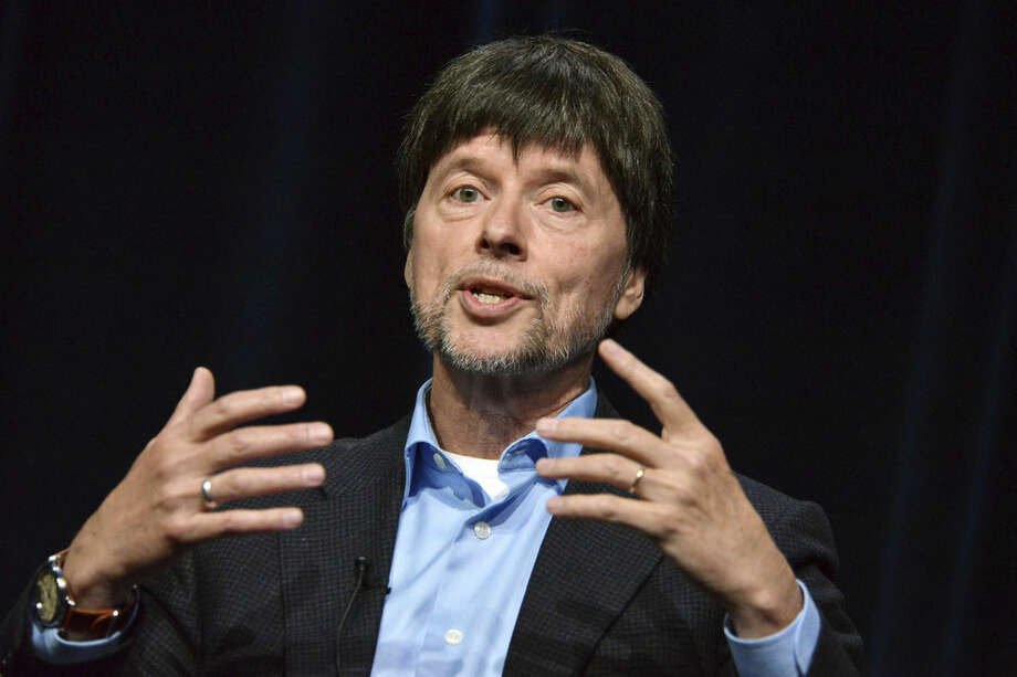 "FILE - In this July 22, 2014 file photo, documentary filmmaker Ken Burns speaks during the ""The Roosevelts: An Intimate History "" panel at the the PBS 2014 Summer TCA in Beverly Hills, Calif. Burns details the connections between two distantly related American presidents in his new documentary series. The 14-hour series unfolds over seven days on PBS, starting Sunday. (Photo by Richard Shotwell/Invision/AP, File)"
