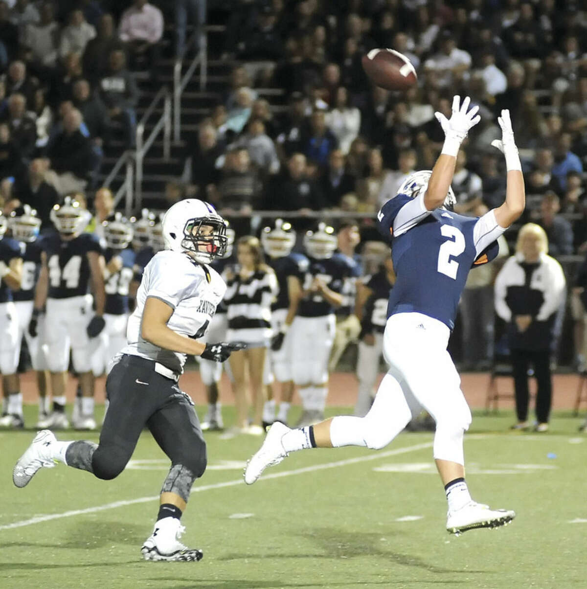 Hour photo/John Nash Staples wide receiver Colin Hoy extends to try to catch a pass as Xavier defensive back Mark Delvecchio closes in.