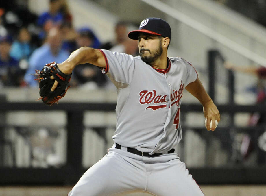 Washington Nationals starting pitcher Gio Gonzalez throws against the New York Mets in the second inning of a baseball game Friday, Sept. 12, 2014, in New York. (AP Photo/Kathy Kmonicek)