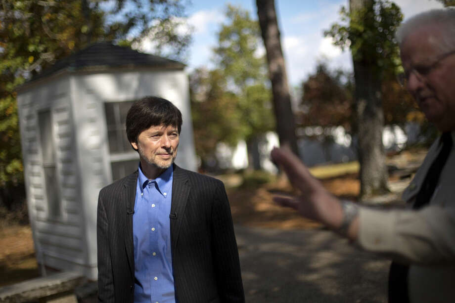 FILE - In this Nov. 2, 2013 file photo, documentary filmmaker Ken Burns walks through the entrance of the Georgia home used by former President Franklin D. Roosevelt during a tour by site manager Robin Glass in Warm Springs, Ga. Burns details the connections between two distantly related American presidents in his new documentary series. The 14-hour series unfolds over seven days on PBS, starting Sunday. (AP Photo/David Goldman, File)